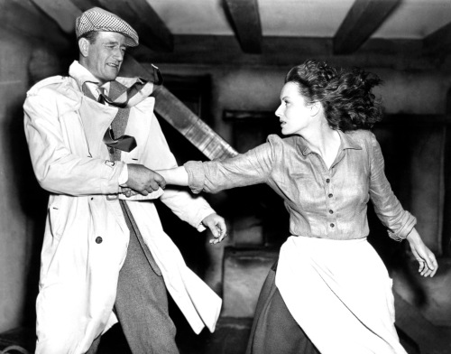 "John Wayne and Maureen O'Hara about to lock lips in ""The Quiet Man""."
