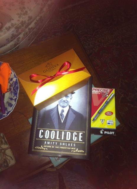 Godiva chocolates, a book and Pilot pens (blue)