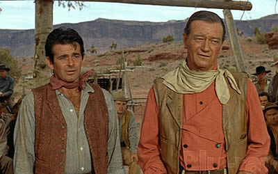 Stuart Whitman (who replaced James Garner, Charlton Heston and several others) and the Duke in that iconic faded red shirt, leather vest and kirchief.