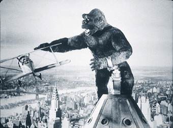 Police aviators doing battle with a big ape in 1933