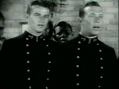 """Here they are in """"Salute"""" (1929)--their first movie together. They appeared with fellow team members of the whole USC football team"""
