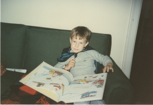 The boy reading about Busytown