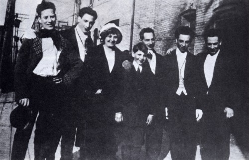 An early photo of the Marx brothers with their parents in New York City, 1915. From left to right: Groucho, Gummo, Minnie (mother), Zeppo, Frenchie (father), Chico, and Harpo.