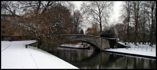 Looking south, down the River Cam, is Simeon's Bridge. In 1816 Simeon financed the major portion of this bridge connecting King's College property on both sides of The Backs. This is also the river into which Simeon threw a guinea (coin) as a self-prescribed punishment for not rising at the hour to which he had committed himself for Bible reading and prayer.