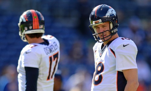 Dec 14, 2014; San Diego, CA, USA; Denver Broncos quarterback Peyton Manning (18) and quarterback Brock Osweiler (17) before the game against the San Diego Chargers at Qualcomm Stadium. Mandatory Credit: Jake Roth-USA TODAY Sports