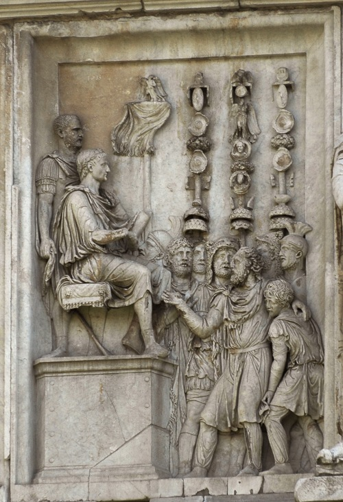 Scene of the emperor's mercy (clementia). Relief on the north side. Marble. A.D. 175—196. Rome, Arch of Constantin.